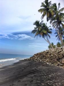 Naked beach, black sand beach